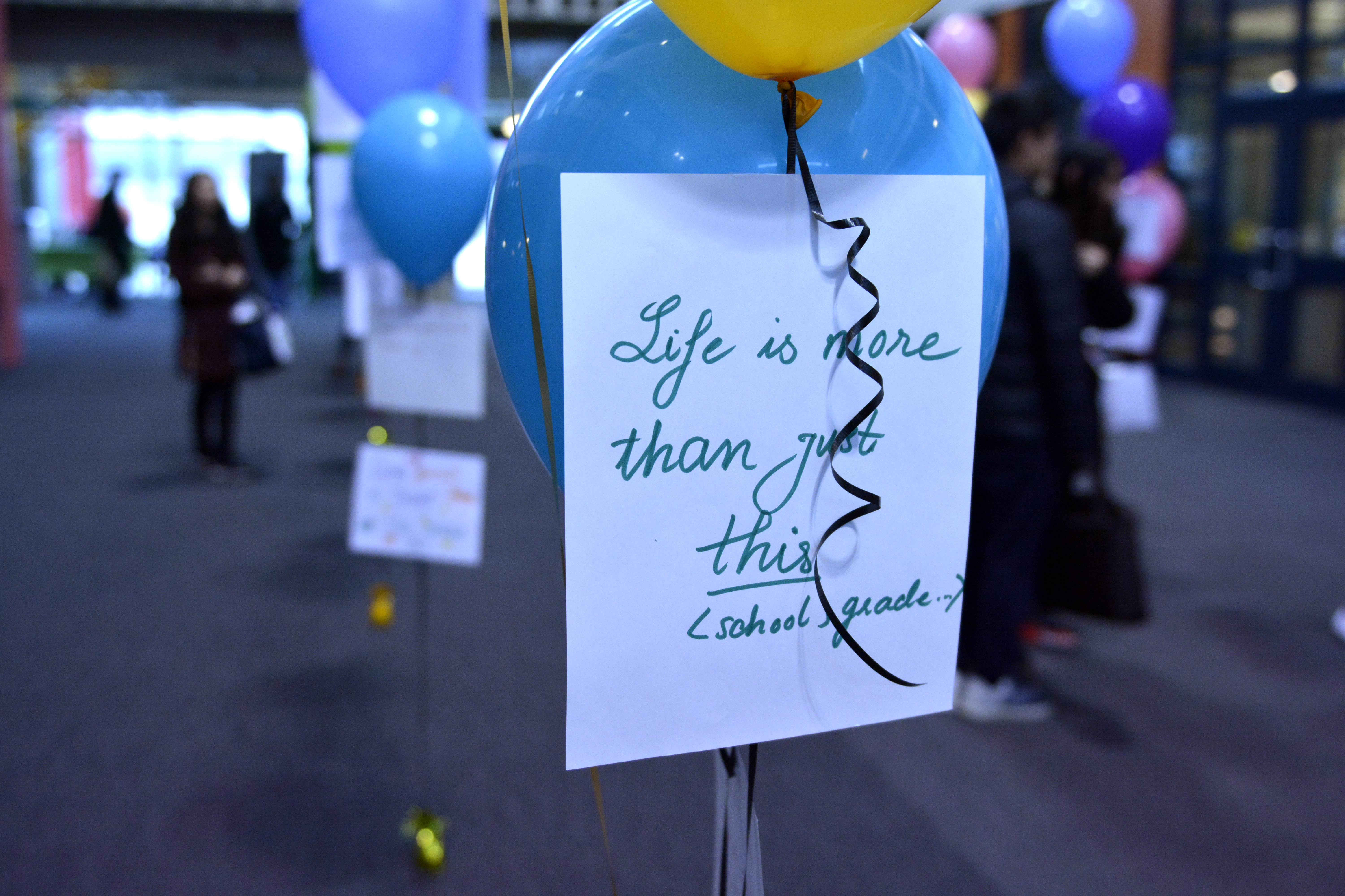 Each installation includes a positive mental health message written by a UW student.