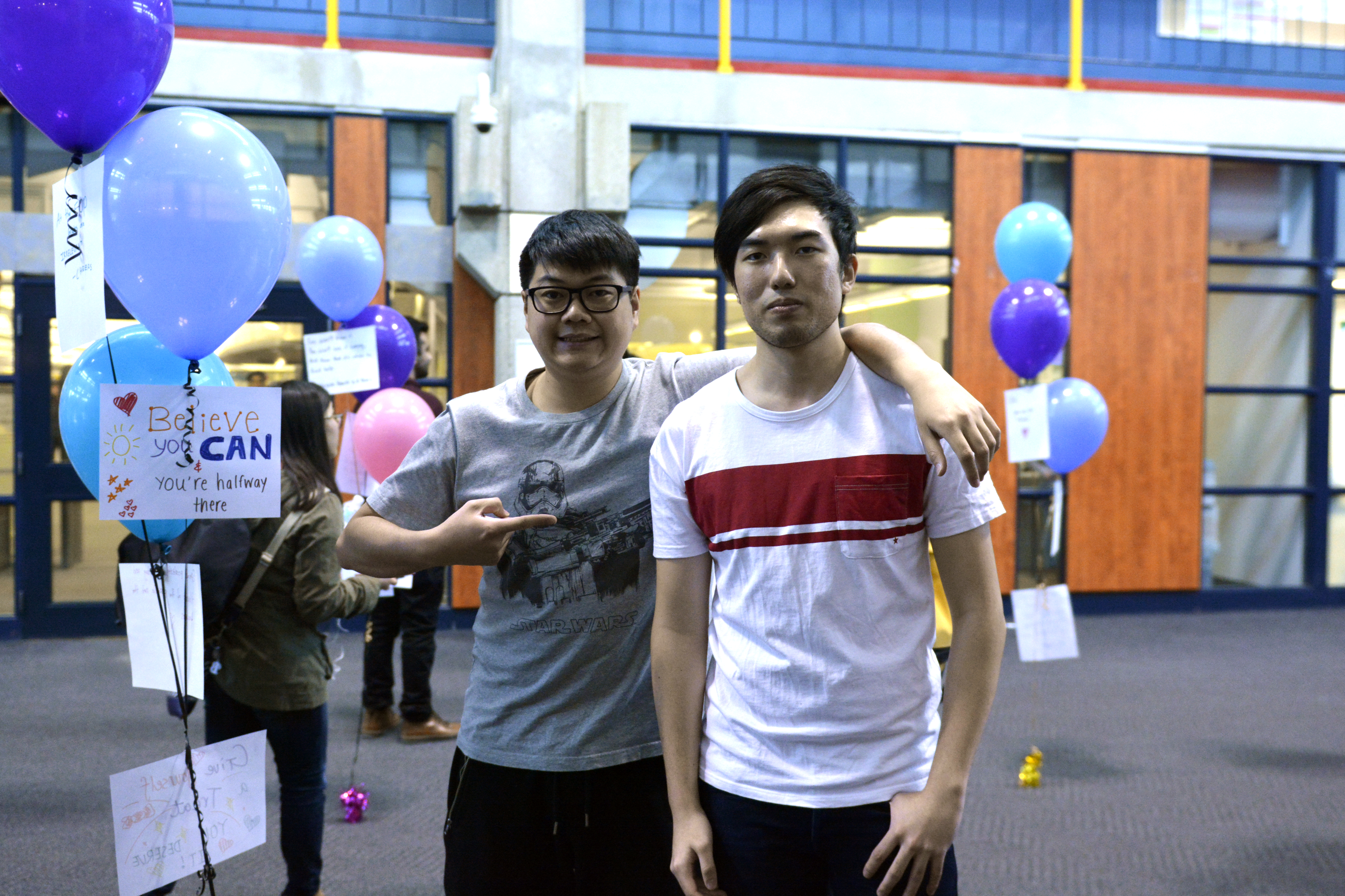 Andrew Cen (left) and Art Tso (right) put the mental health balloon project together.